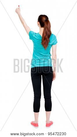 Back view of  woman thumbs up. Rear view people collection. backside view of person. Isolated over white background. Sport girl shows a thumbs-up.