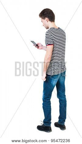 back view of man in suit  talking on mobile phone.    rear view people collection. Isolated over white background. backside view of person. The guy in the striped shirt looking at the cell phone.