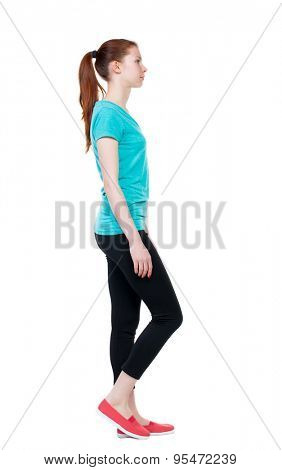 side view of walking  woman in sports tights. beautiful girl in motion.  backside view of person.  Rear view people collection. Isolated over white background. Sport girl goes to left and looks ahead.