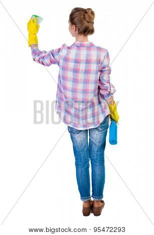Back view housewife in gloves with sponge and detergent. girl  watching. Rear view people collection.  Isolated over white background. young girl engaged in cleaning. Girl green sponge wash something