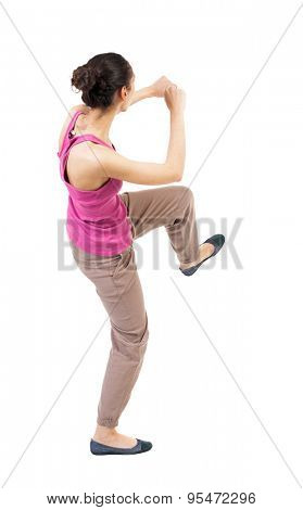 skinny woman funny fights waving his arms and legs. Rear view people collection.  backside view of person.  Isolated over white background. African-American boxing.
