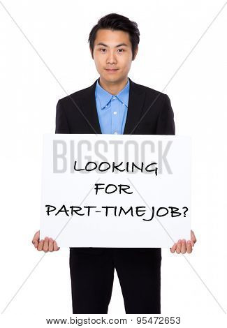 Asian businessman holding a placard showing with looking for part-time job phrases
