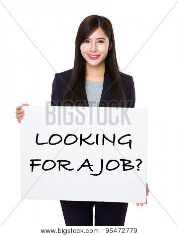 Beautiful businesswoman showing a placard showing with looking for a job phrases