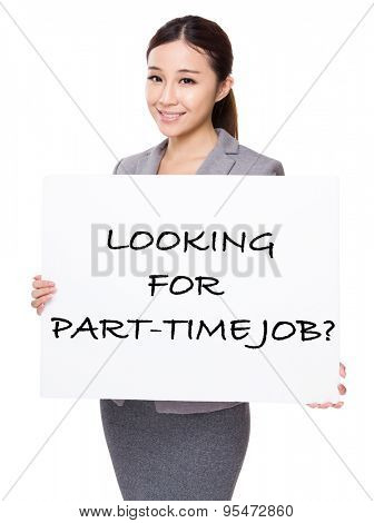 Confident businesswoman holding a board showing with looking for part-time job phrases