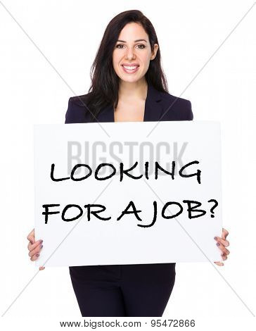 Confident businesswoman holding a placard showing with looking for a job phrases