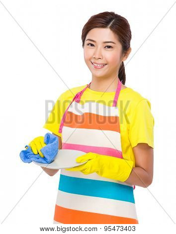 Housewife wash the dishes with plastic gloves