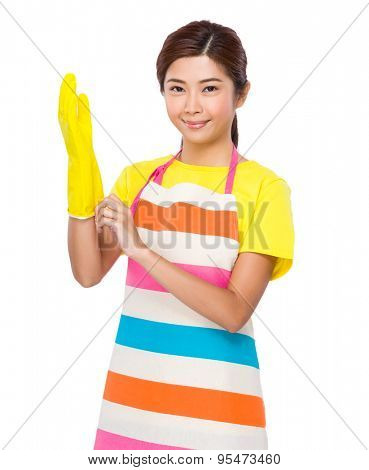 Asian housewife wear with the plastic gloves