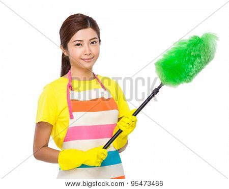 Asian housewife clean up with duster