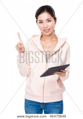 Asian woman holding with tablet and finger showing up