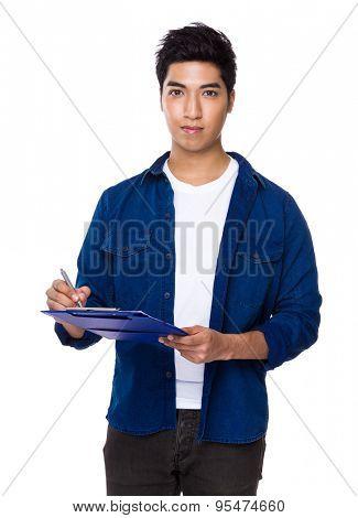 Asian man write on the file board