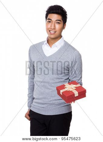 Iranian mixed chinese businessman holding up with red gift box