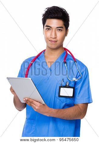 Young doctor use of the tablet pc