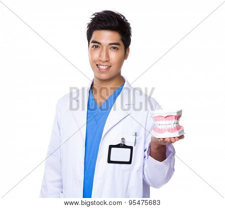 Dentist holding with denture