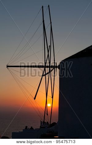 oia mill at sunset santorini island greece