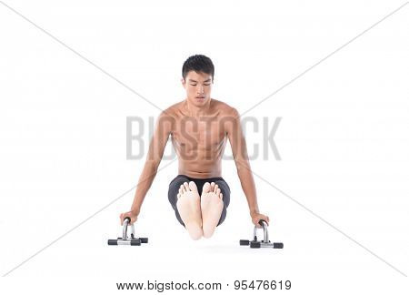 muscular young man lifting weights on white background
