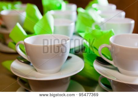White Cups And Saucers Standing Exactly On The Table