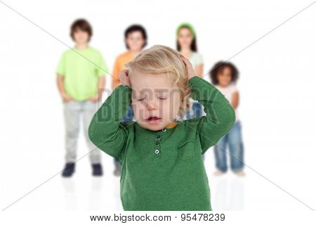 Blond baby worried with his brothers of background isolated