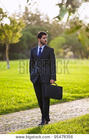 Businessman walking at the park