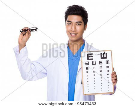 Optical doctor holding with eyechart and glassesa