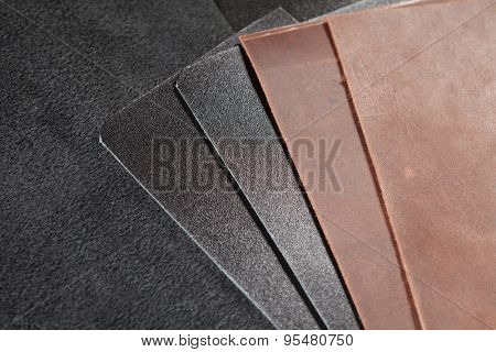 Pieces of brown and black leather. nubuck pieces of brown and black leather