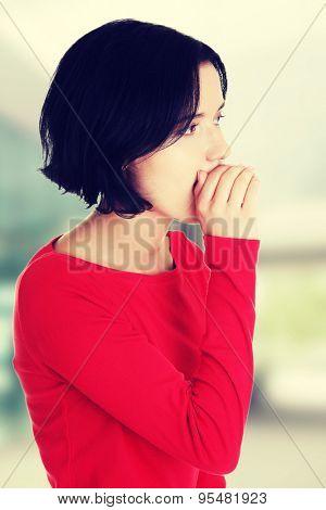 Beautiful woman whispering a message