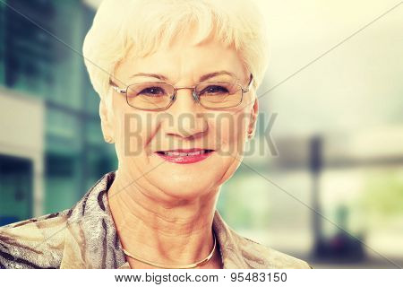 Portrait of an old lady in eyeglasses