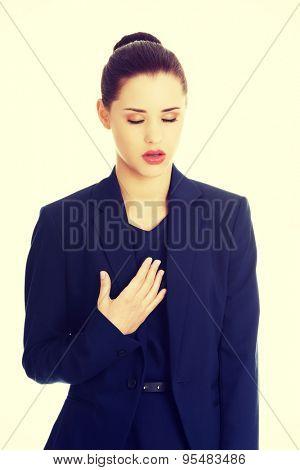 Young beautiful businesswoman heart disease