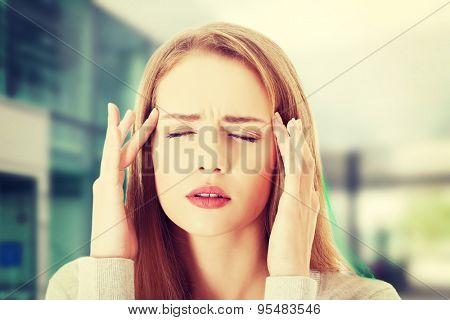Young woman with huge head ache