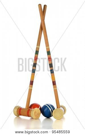 Vintage mallets and balls of croquet game isolated over white background - With clipping path