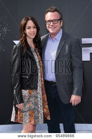 LOS ANGELES - JUN 28:  Tom Arnold & Ashley Groussman arrives to the