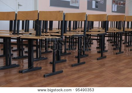 Rows of wooden chairs in the hall
