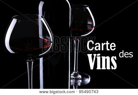 Wineglasses with red wine on black background