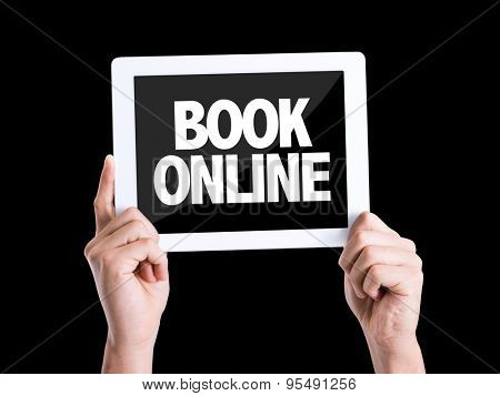 Tablet pc with text Book Online isolated on black background