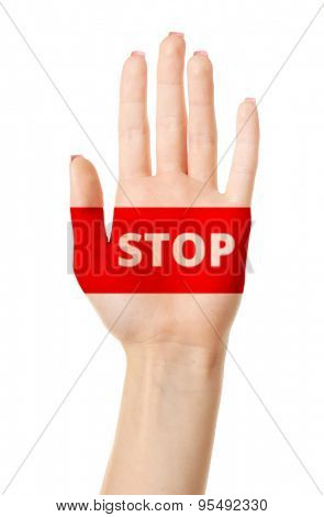Female hand with sign STOP isolated on white