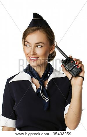 Beautiful smiling stewardess with cb radio, isolated on a white background