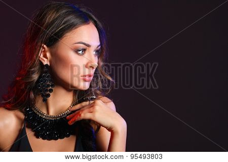 Portrait of a beautiful woman with necklace .