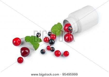 Berries Spilling Out Of Pills Bottle Isolated On White