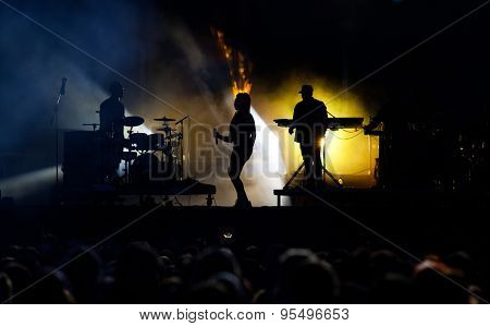 BONTIDA, ROMANIA - JUNE 28, 2015: Silhouettes of singers performing live on stage at Electric Castle festival, one of the biggest music festivals in Romania