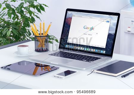 Apple Macbook Pro On The Office Desk With An Open Tab In Safari Which Shows Google Search Page