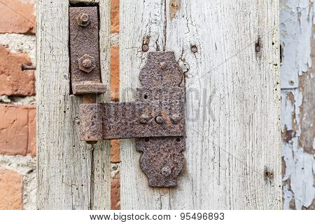 Rusty Hinge On Old Wooden Door, Rustic Background.