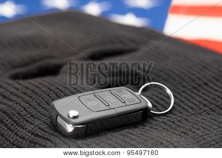 Car Keys On Black Mask And Usa Flag