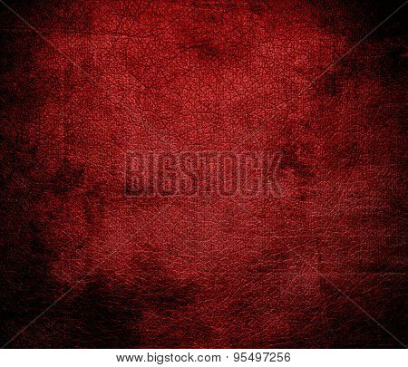 Grunge background of crimson red leather texture