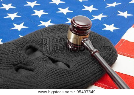 Thief Mask And Judge Gavel Over It Us Flag