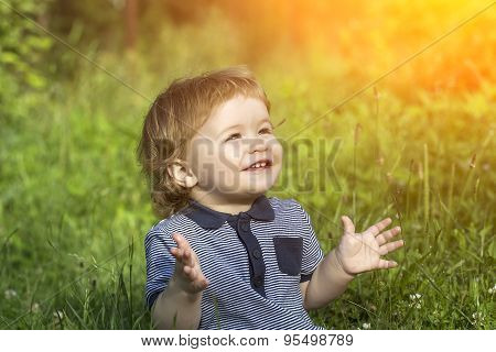 Happy Baby Boy On Grass