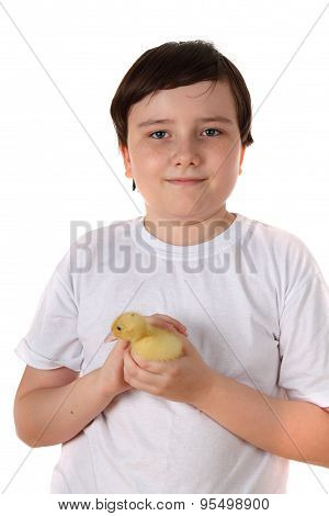 Smiling Boy Holding A Duckling