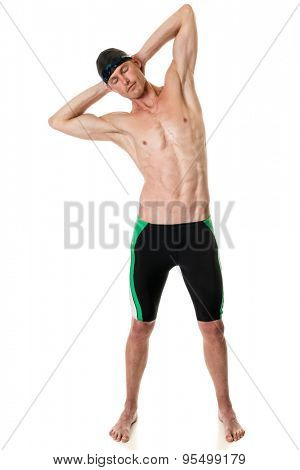Young adult swimmer. Studio shot over white.