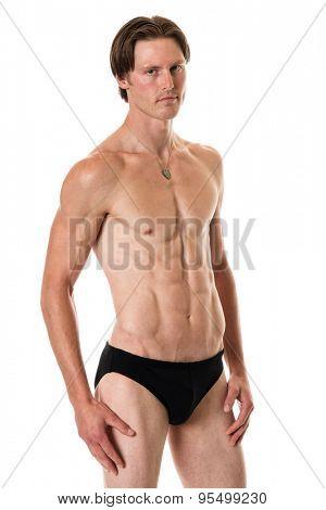 Man in swimwear. Studio shot over white.