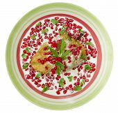 pic of poblano  - Chile en Nogada Mexican dish made from a poblano chile with a fried egg cover walnut sauce and pomegranate seeds for flavor - JPG