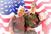 picture of reunited  - Solider reunited with parents against rippled us flag - JPG