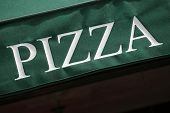 image of canopy  - Pizza sign printed on a green entrance canopy - JPG